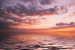 Sunset on the sea Stock Images