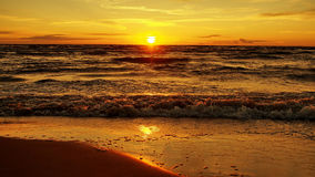 Sunset on sea coast Royalty Free Stock Image
