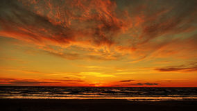 Sunset orange clouds sea coast Royalty Free Stock Photo