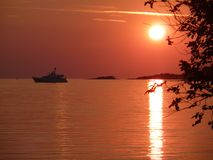 Sunset at sea in Croatia. Beautiful orange red colors and reflection in the sea royalty free stock photo