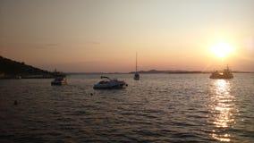 Sunset on sea stock photos