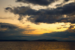 Sunset on sea. dark clouds in the sky Stock Image