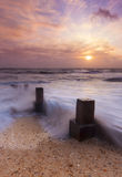 Sunset and sea defences Royalty Free Stock Images