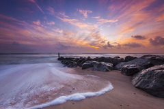 Sunset and sea defences Royalty Free Stock Image