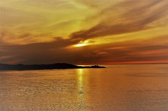 Sunset by the sea in early spring. royalty free stock photos