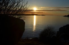 Sunset by the sea in early spring. Royalty Free Stock Photo