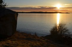 Sunset by the sea in early spring. royalty free stock images