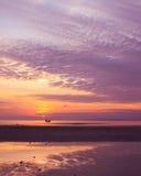 Sunset on sea during ebb Stock Photo