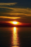 The sunset at the sea. The sunset in the evening at the Baltic sea Royalty Free Stock Photography