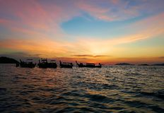Sunset In the sea. Fishing boats are going home. stock photo