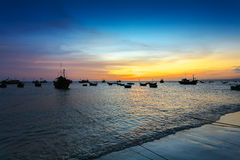 Sunset in the sea fishing port Stock Photos