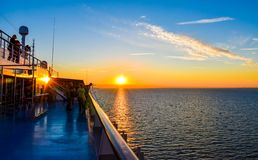 Sunset on the sea between Germany and Denmark on the Fehmarnbelt waterway, with a view from aboard a passenger ship. Puttgarden, Germany - July 14, 2017: Sunset stock photo