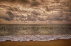 Sunset sea  with  gray sky background Stock Photography