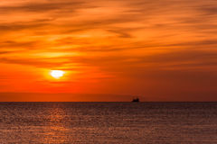 Sunset on sea. The sunset on sea always has a special charm. Especially when it happens to be there also a fishing boat Stock Image