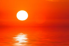 Sunset sea horizon. Orange sunset: sun, clouds and the sea surface with waves Royalty Free Stock Images