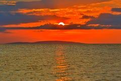 Sunset on sea. Hot red sunset over sea Stock Photo