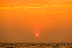Sunset at the sea. Image shows the sun setting over the sea Royalty Free Stock Photography