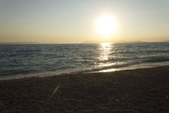 Sunset by the sea inTucepi, Croatia, nobody around. TUCEPI, CROATIA - AUGUST 15 2017:Sunset by the sea inTucepi, Croatia, nobody around Stock Photo