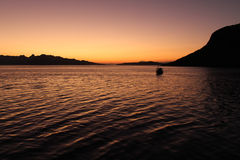Sunset at sea in the Komodo Islands, Indonesia Royalty Free Stock Photos