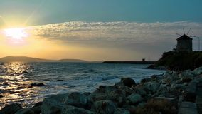 Sunset Sea and Mill House stock footage