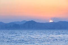 Sunset with sea and mountains royalty free stock photography
