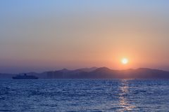 Sunset with sea and mountains Royalty Free Stock Photo