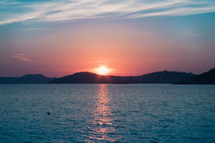 Sunset by the sea in Mykonos Stock Photo