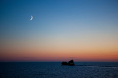 Sunset on the sea. With new moon Royalty Free Stock Photo