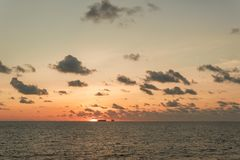 Sunset at sea. Offshore oil and gas industry. Sea oil production and storage on background Stock Photos