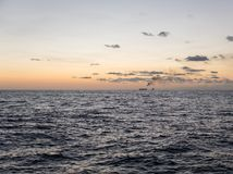 Sunset at sea. Offshore oil and gas industry. Sea oil production and storage on background Royalty Free Stock Photography