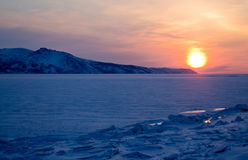 Sunset on the Sea of Okhotsk, Magadan. Winter landscape Royalty Free Stock Photo