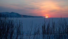 Sunset on the Sea of Okhotsk, Magadan. Winter landscape Stock Photos