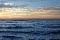 Sunset by the sea, orange glow. Royalty Free Stock Image
