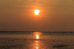 Sunset at the sea with orange, yellow, red and pink sky Royalty Free Stock Photos