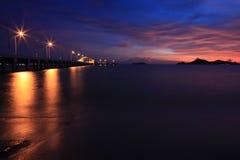 Sunset. Sea pier silhouette Stock Photos