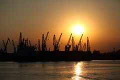 Sunset at the sea port. Sunset at the industrial zone on the sea port Royalty Free Stock Photos