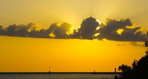 Sunset in the sea port. Sunset in the sea town overlooking the lighthouse Royalty Free Stock Photography
