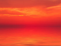 Sunset sea red background. Sunset red background: sun, clouds and the sea surface with waves Stock Images