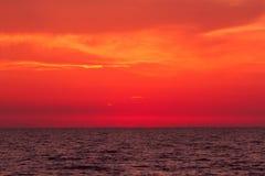 Sunset sea red Stock Photos