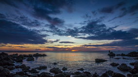 Sunset on sea in rocks bay time lapse stock footage
