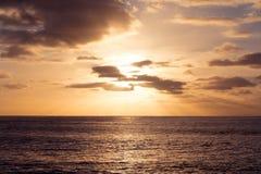 Sunset at sea. Romantic sunset on the serene sea Stock Images