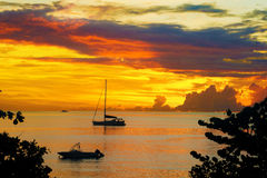 Sunset in sea and sailing yacht silhouette with beautiful landscape of Caribbean Stock Photography