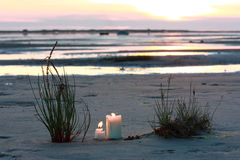 Sunset Sea Sand Candles. Reflexion of light of the sunset Stock Image