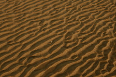 Sunset sea sand surface Stock Images