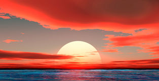 Sunset on the sea. With scarlet clouds Royalty Free Stock Photo