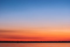 Sunset at sea. With shades of orange, magenta and blue in the sky Royalty Free Stock Images