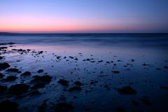 Sunset sea shore Stock Photography