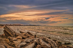 Sunset at the sea shore of a beach with rocks and stormy waves, beautiful seascape at Caspian sea Absheron, Azerbaijan Novkhani. Sunset at the sea shore of a Stock Photos