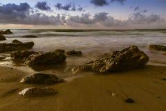 Sunset at sea. The Sicilian coast at sunset Stock Photos