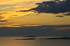 Sunset at sea, with small greek islands in background, Sithonia Royalty Free Stock Photos